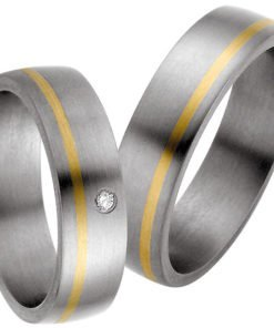 Titanium wedding ring with offset yellow gold stripe