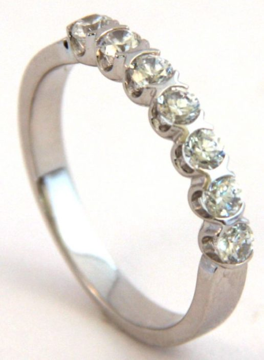 Half eternity diamond wedding ring with a white gold band